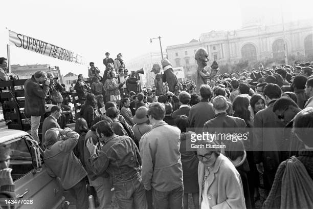 View of attendees as they listen to a speaker at a rally in support of a San Francisco State College students strike near San Francisco City Hall San...