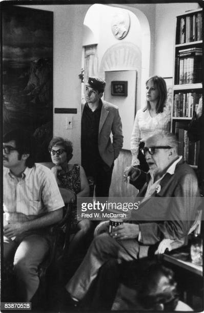 View of attendees including American political activist Tom Hayden as they listen to speakers at an informal meeting of Students for a Democratic...