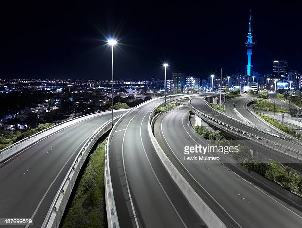 View of Auckland city with empty freeway at night
