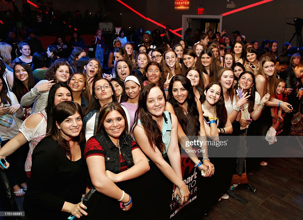 A view of audience members as Z100 hosts a live chat and performance with singer Austin Mahone to celebrate the world premiere of his new single, 'What About Love,' at the iHeartRadio Theater presented by P.C. Richard & Son on June 7, 2013 in New York City.