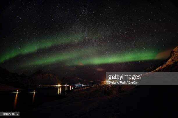 View Of Aurora Borealis Over Landscape At Night