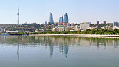 View of Baku downtown with Flame Towers skyscrapers and TV tower from Caspian Sea, Azerbaijan