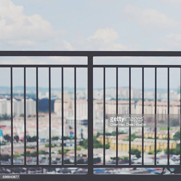 View Of Balcony Balustrade, Townscape In Background