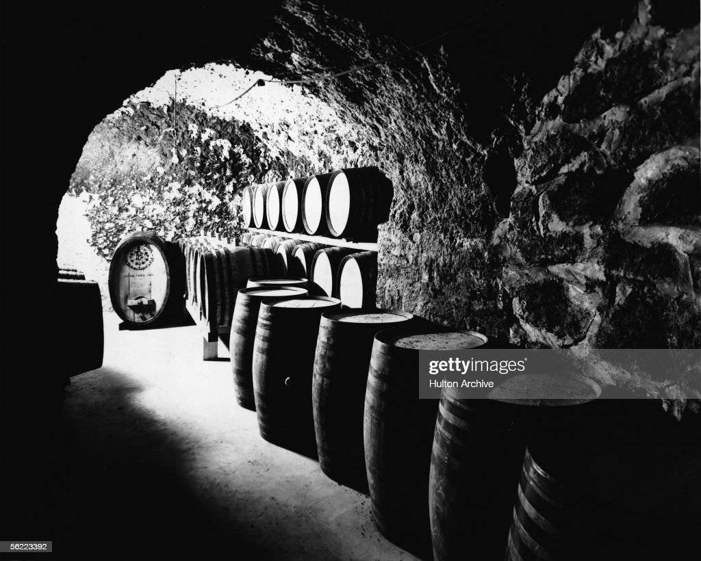 View of barrels of wine in a tunnel at the Beringer Brothers Winery, St. Helena, California, 1900s.