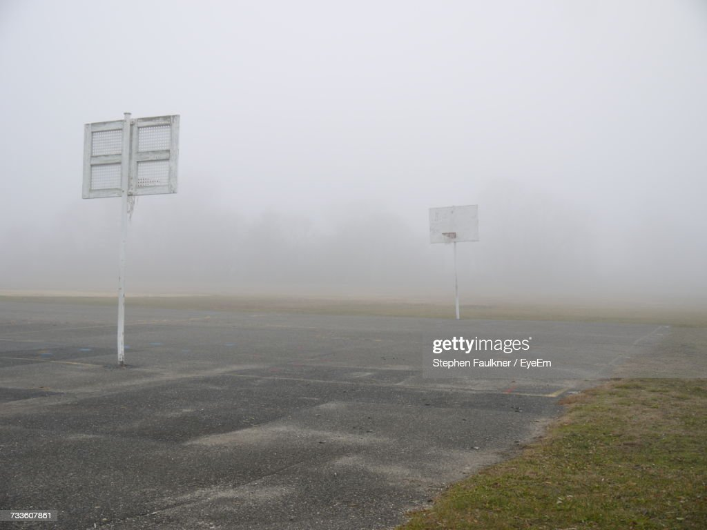 view of basketball hoop in foggy weather stock photo getty images