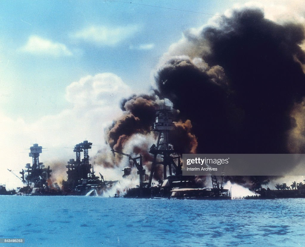 View of battleship row as explosions damage three American battleships during the Japanese attack on Pearl Harbor Honolulu Oahu Hawaii December 7...