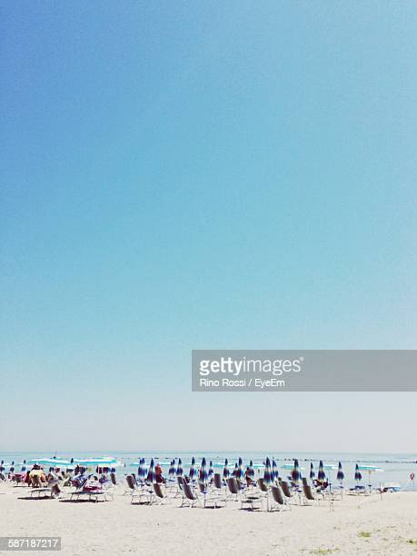 View Of Beach Against Clear Blue Sky