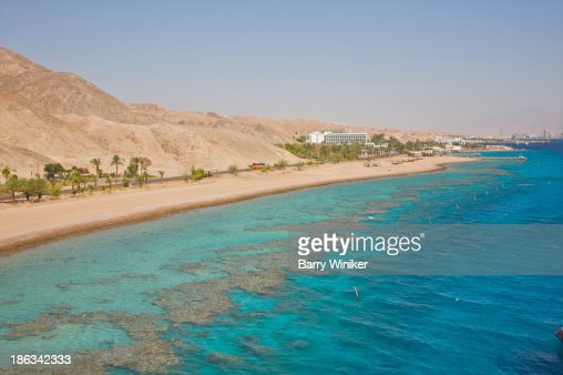 View of beach, coral & blue waters of Red Sea