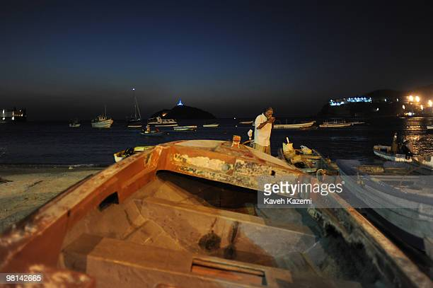 A view of beach front at night with fishing boats at shore Santa Marta is a city and municipality located in northern Colombia by the Caribbean sea...