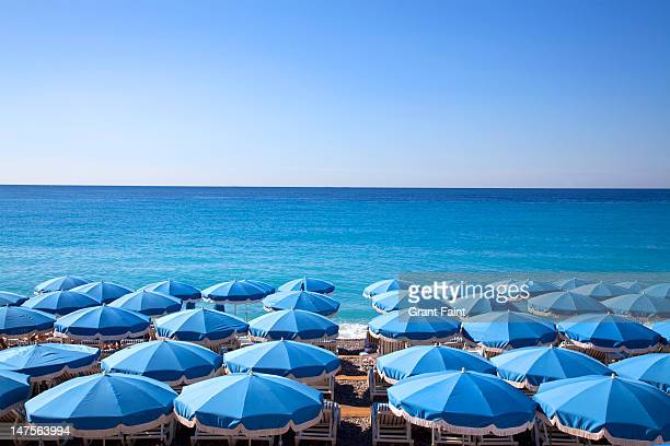 View of beach huts umbrellas.
