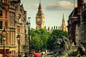 View of Big Ben and Whitehall from Trafalgar Square in London at sunset