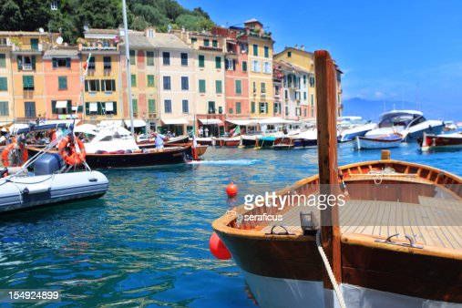 View of boats in Portofino with city in the background