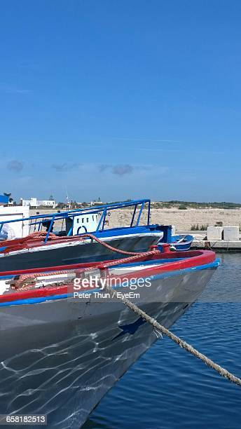 View Of Boats In Sea Against Blue Sky