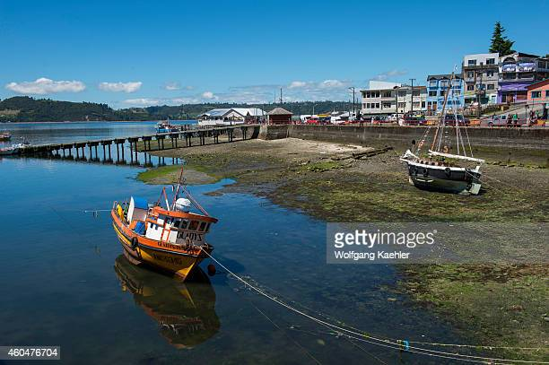 View of boats in the harbor at low tide in front of the town of Castro on Chiloe Island in southern Chile