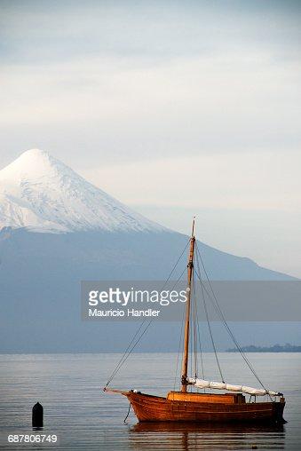 View of boats on Lake Llanquihue and Osorno Volcano, Puerto Varas, Chile.
