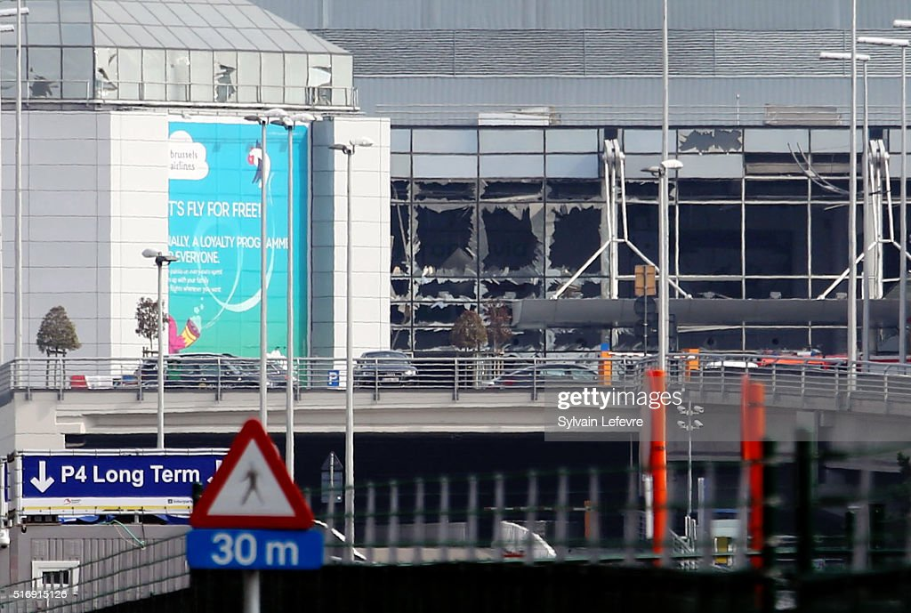 A view of bomb damage as passengers are evacuated from Zaventem Bruxelles International Airport after a terrorist attack on March 22 2016 in Brussels...