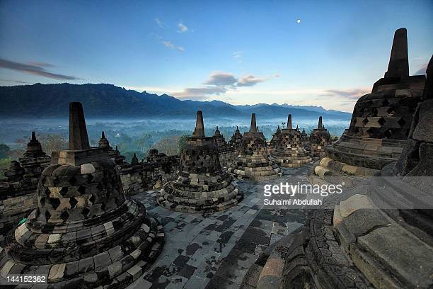 A view of Borobudur temple at sunrise on April 9 2012 in Java Indonesia Borobudur the famous Buddhist temple is listed as a UNESCO World Heritage...