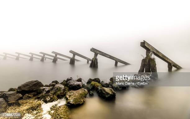 View Of Bridge Over Sea During Foggy Weather
