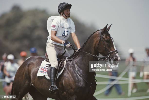 View of British equestrian Mary King of the Great Britain team in action riding King William during competition in the cross country section of the...