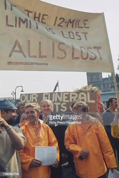 View of British fishermen protesting with Robert Boothby Lord Boothby outside the Palace of Westminster on the upcoming threat to British territorial...