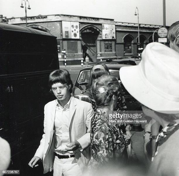 View of British musician Mick Jagger of the group the Rolling Stones as arrives at a wedding London England August 19 1965