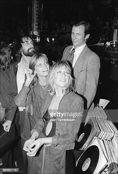 View of British musicians Mick Fleetwood and Christine McVie both of the group Fleetwood Mac and American married couple model Cheryl Tiegs and...