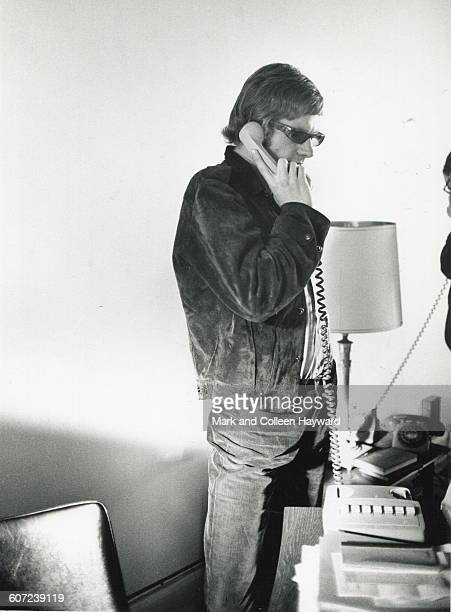 View of British producer Andrew Loog Oldham talks on the telephone September 24 1964