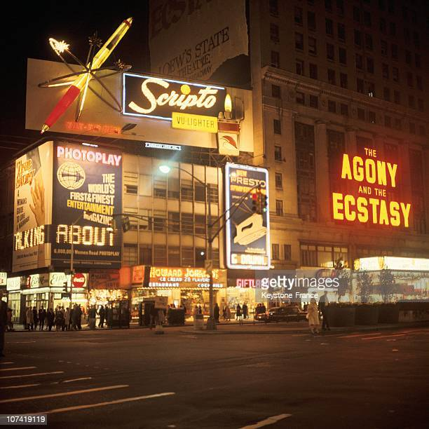 View Of Broadway By Night With Its Neon Signs And Its Streets In New York During The Seventies