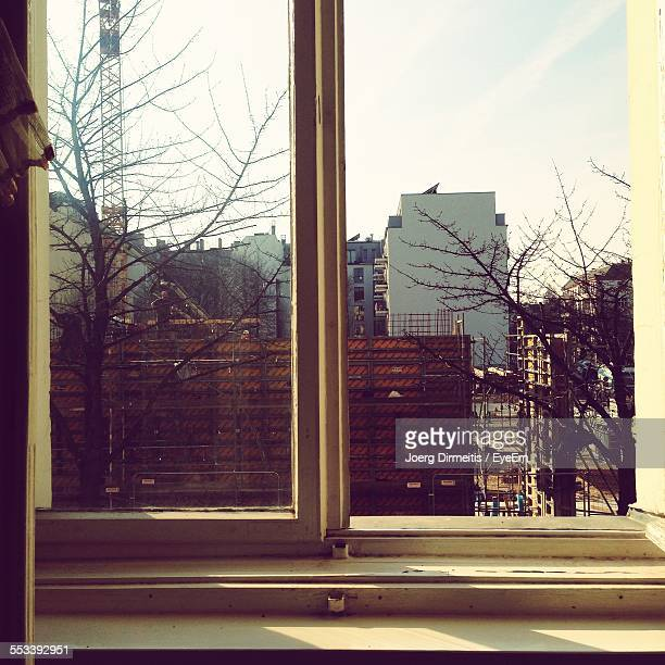 View Of Buildings Through Window