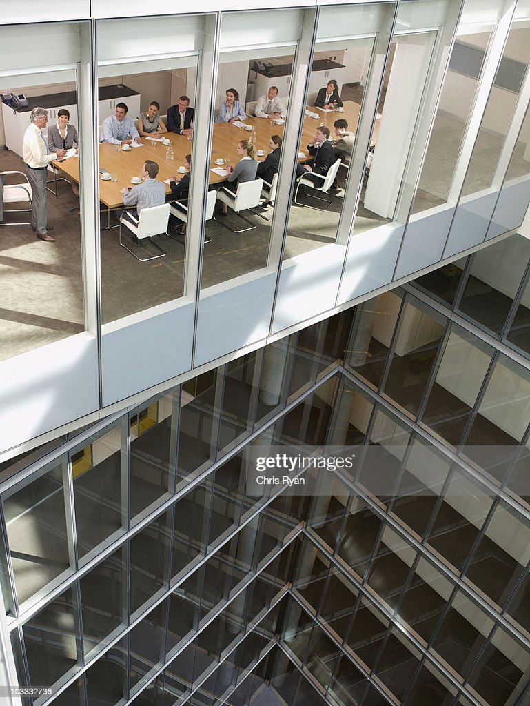 View of business people in conference room of highrise building : Stock Photo