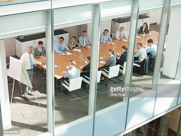 View of business people in conference room of highrise building