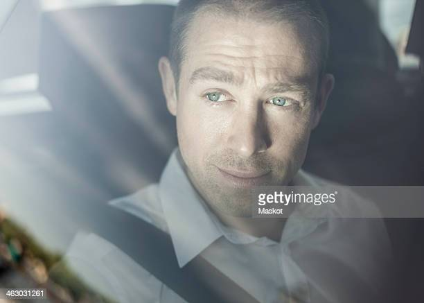 View of businessman looking through taxi window