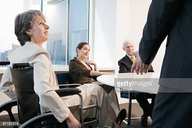 View of businesspeople sitting in an office