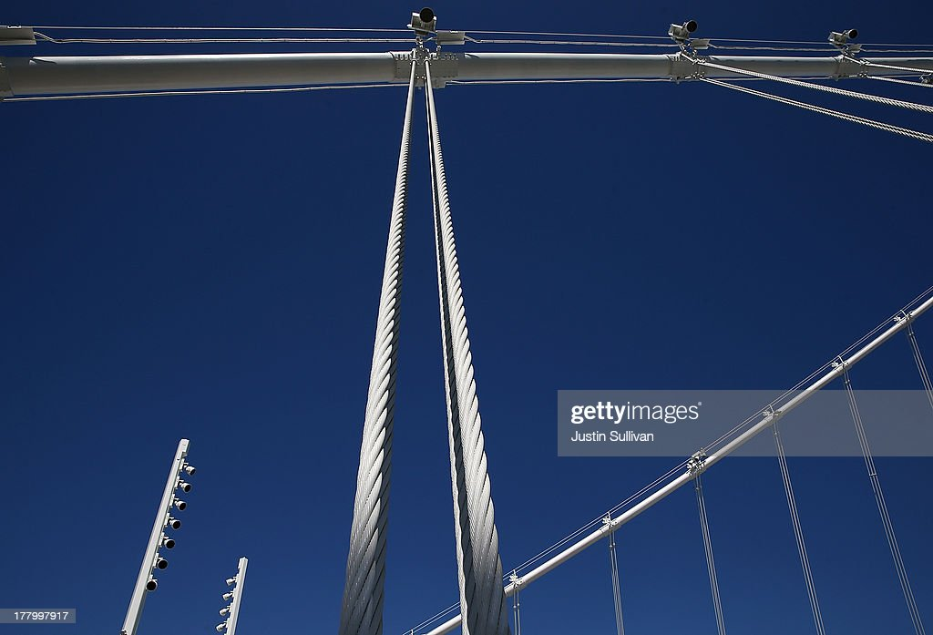A view of cables that hang from the new Bay Bridge Self-Anchored Suspension (SAS) tower on August 26, 2013 in San Francisco, California. After nearly 12 years of construction and an estimated price tag of $6.4 billion, the new eastern span of the Bay Bridge is set to open on September 3. The bridge will be the world's tallest Self-Anchored Suspension (SAS) tower once completed.