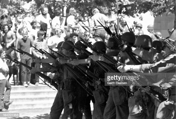 View of California National Guardsmen bayonets at the ready during protests near People's Park on the campus of the University of Berkeley Berkeley...