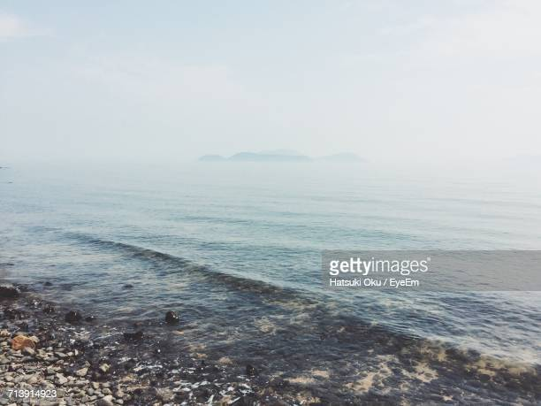 View Of Calm Sea Against Sky During Foggy Weather