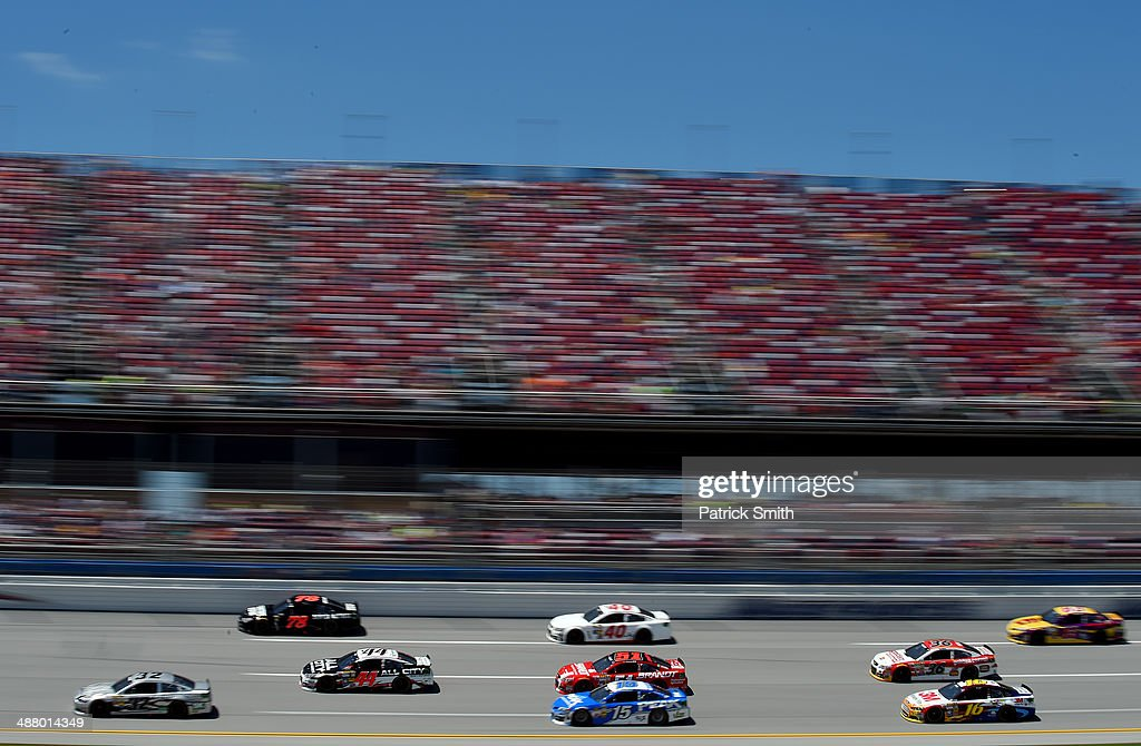A view of cars on track during qualifying for the NASCAR Sprint Cup Series Aaron's 499 at Talladega Superspeedway on May 3, 2014 in Talladega, Alabama.