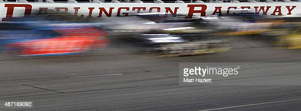 A view of cars racing during the NASCAR Sprint Cup Series Bojangles' Southern 500 at Darlington Raceway on September 6 2015 in Darlington South...