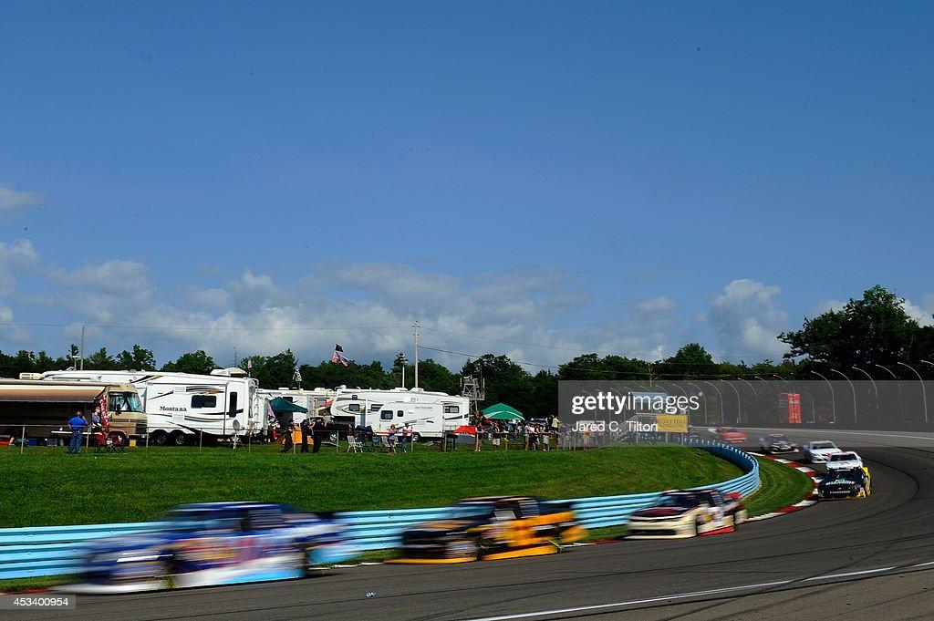 A view of cars racing the NASCAR Nationwide Zippo 200 at Watkins Glen International on August 9 2014 in Watkins Glen New York