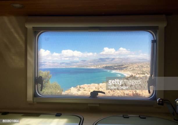 View of Castellamare del Golfo, Sicily, through camper window