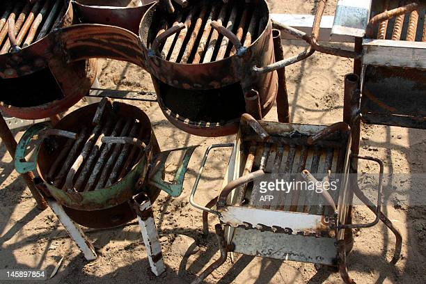 A view of charcoal stoves on sale at a roadside stall in the Mozambican capital Maputo on May 16 2012 Until now charcoalfueled stoves are the most...