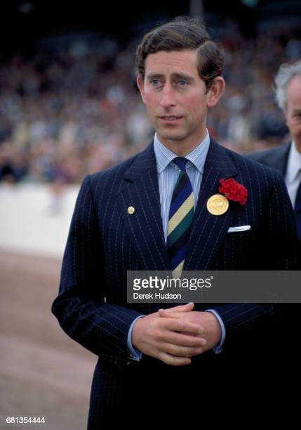 View of Charles Prince of Wales dressed in a chalkstripe singlebreasted navy blue suit with a carnation in the lapel as he attends the East of...