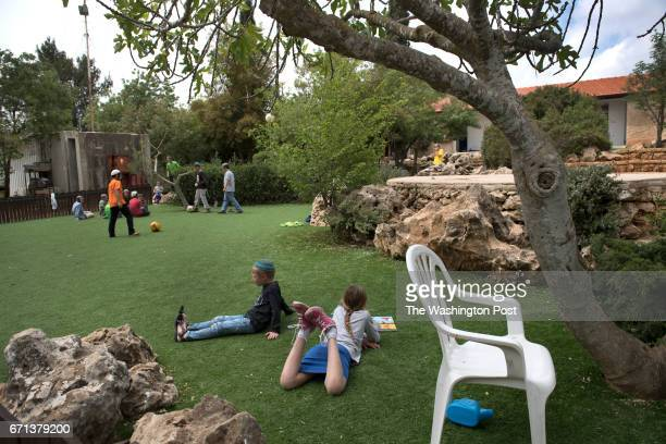 View of children of Amona israeli settlers as they play in a common area at a hostel in Ofra West Bank on April 9 2017 After the Israeli Supreme...