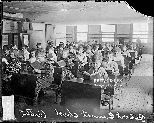 View of children reading at desks in a classroom at the Robert Emmet School looking at the children from the front of the classroom in the Austin...