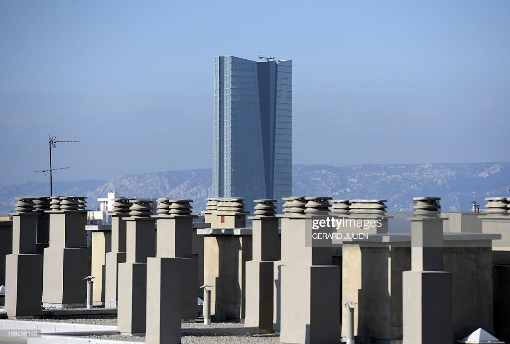 A view of chimneys with the CMA CGM tower in the background, in Marseille, on January 10, 2013. On January 12, the city will be named 'capital of culture' which will kick off a range of exhibitions and events. AFP PHOTO / GERARD JULIEN