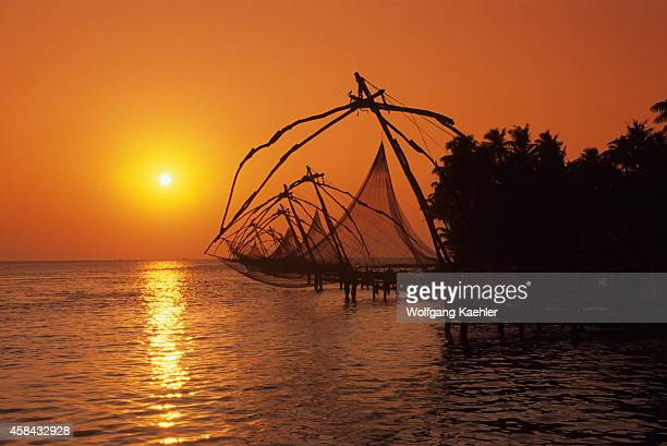 View of Chinese fishing nets in sunset at a bay at Cochin in India