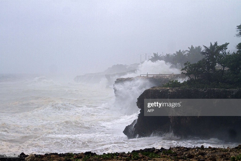 View of choppy seas in front of Santo Domingo's Malecon seafront on July 10, 2013. After whipping up winds approaching hurricane strength, Tropical storm Chantal in the Caribbean may weaken into a 'tropical wave,' the National Hurricane Center said Wednesday. As the storm continues to move northwest with maximum sustained winds of 45 miles (75 kilometers) per hour, tropical storm warnings for Puerto Rico and the US Virgin Islands have been canceled. They remained in effect for the coasts of the Dominican Republic and Haiti, the Miami-based center said in its 0900 GMT bulletin. AFP PHOTO/ERIKA SANTELICES