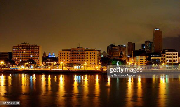 View of city and river at night