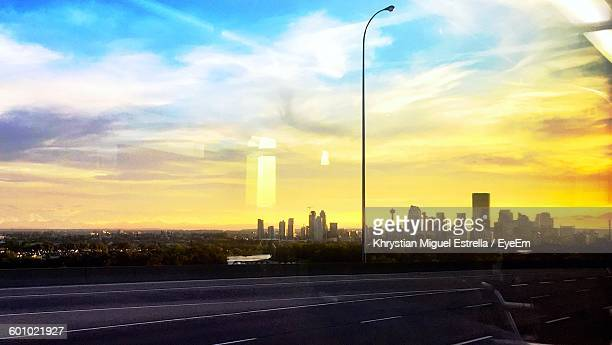 View Of City Street And Cityscape Against Sky During Sunset