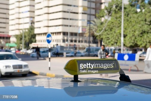 View of City Street Over the Roof of a Taxi. Abu Dhabi, United Arab Emirates